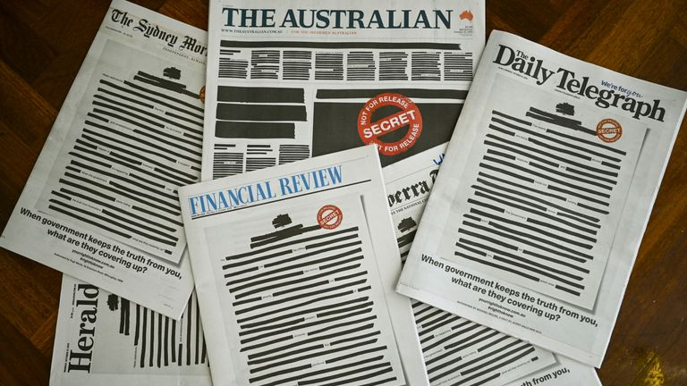 "Front pages of major Australian newspapers show a 'Your right to know"" campaign, in Canberra, Australia, October 21, 2019. Australia's biggest newspapers ran front pages on Monday made up to appear heavily redacted to protest against recent legislation that restricts press freedoms, a rare show of unity by the usually tribal media industry"