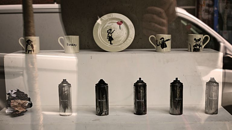 Plates, mugs and graffiti cans are part of the display. Pic: MR FOX CROYDON