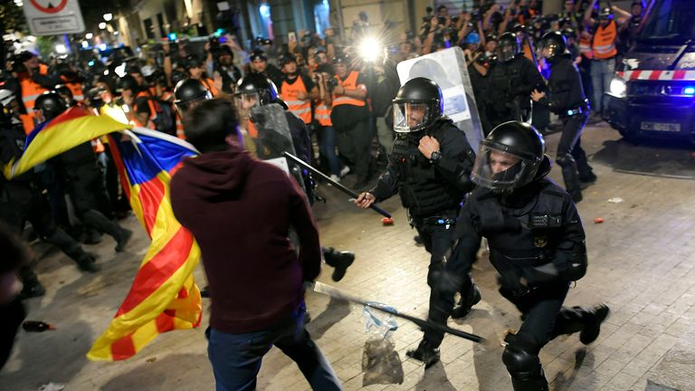 Police clash with pro-independence protesters during a demonstration called by the local Republic Defence Committees (CDR)