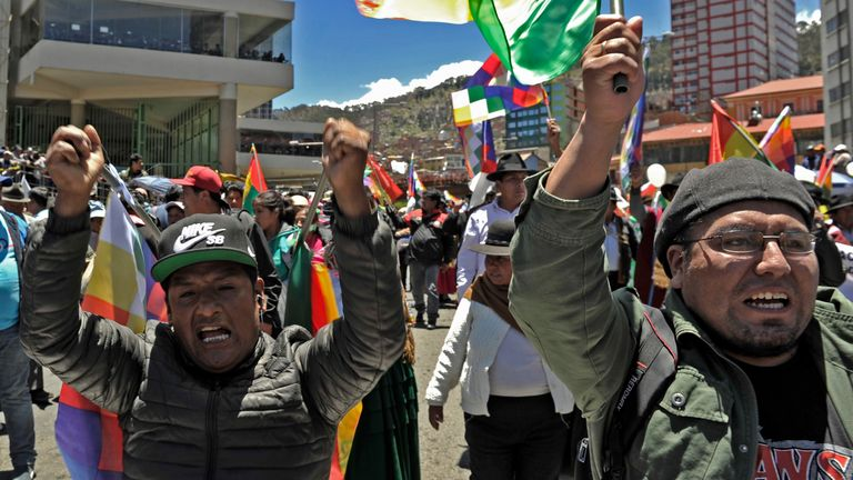 Supporters of Bolivian president Evo Morales march to show their support as the opposition disputes results announced by the electoral court on Monday that suggested an outright Morales victory in the first round of the presidential election held on the weekend, in La Paz on October 23, 2019