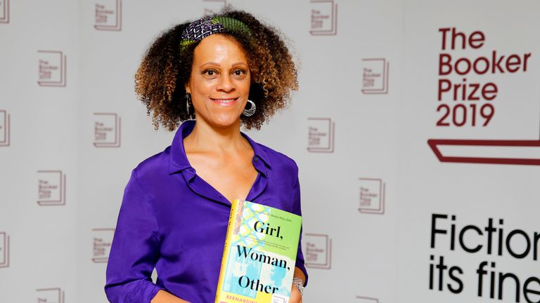 British author Bernardine Evaristo poses with her book Girl, Woman, Other during the photo call for the authors shortlisted for the 2019 Booker Prize for Fiction at Southbank Centre in London on October 13, 2019