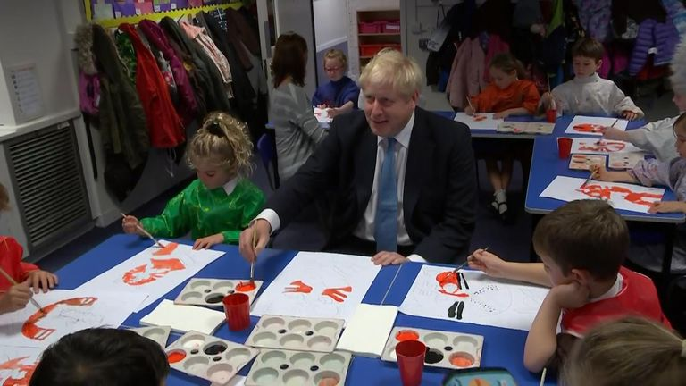 The prime minister joined schoolchildren in painting tigers, inspired by the work of Henri Rousseau.
