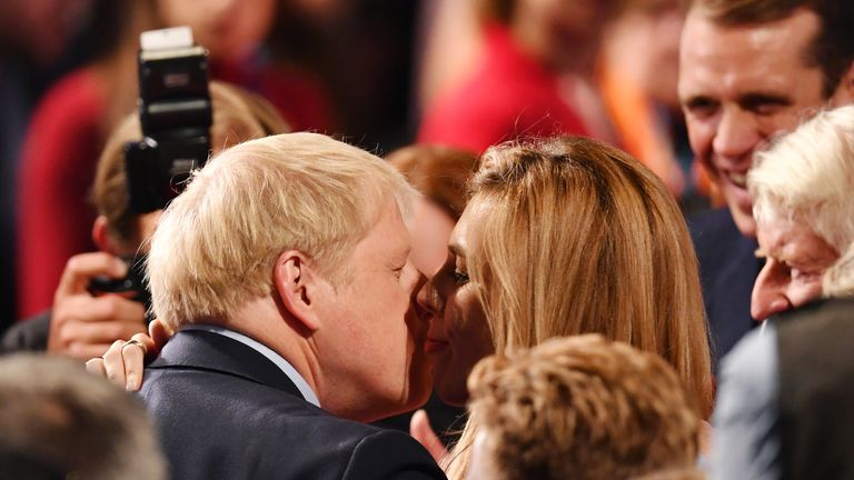 Boris Johnson embraces his girlfriend Carrie Symonds following his keynote speech