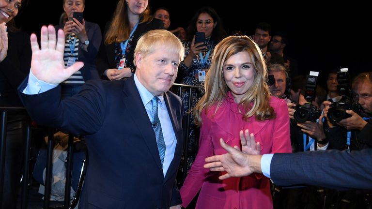Boris Johnson is joined by his girlfriend Carrie Symonds after delivering his keynote speech