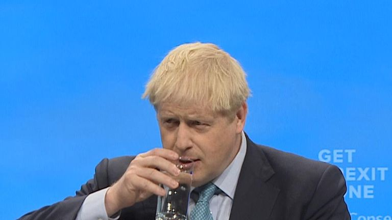 Boris Johnson pauses for water during his first Conservative Party conference address as prime minister
