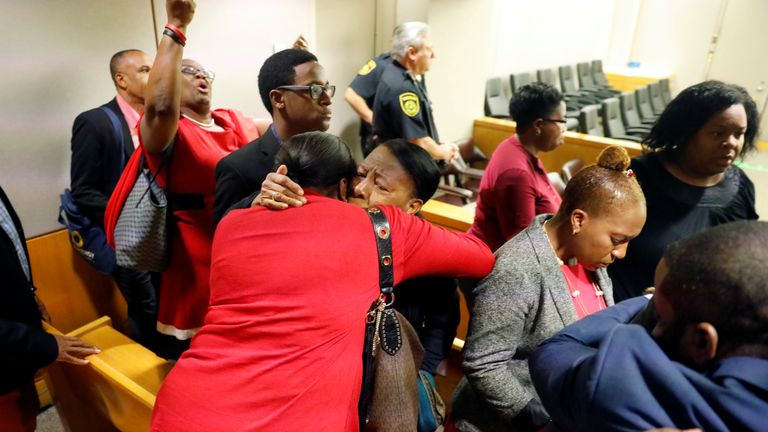 Botham Jean's family hugged and whooped after Amber Guyger was convicted of murder - but her 10 year sentence drew jeers