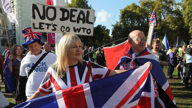 """Pro-Brexit demonstrators are seen in Parliament Square in central London on October 19, 2019, ahead of a rally by activists from the People's Vote organisation who are calling for a second referendum on Brexit. - Thousands of people march to parliament calling for a """"People's Vote"""", with an option to reverse Brexit as MPs hold a debate on Prime Minister Boris Johnson's Brexit deal. (Photo by ISABEL INFANTES / AFP) (Photo by ISABEL INFANTES/AFP via Getty Images)"""