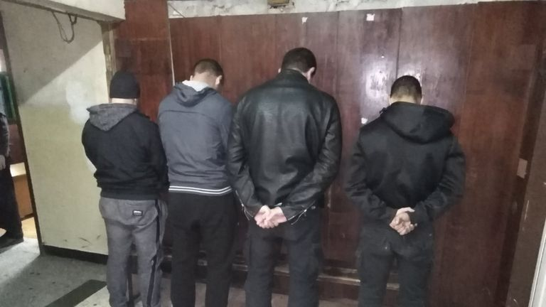 The four fans were pictured with their backs to the camera after being detained by police. Pic: Bulgaria Ministry of Interior