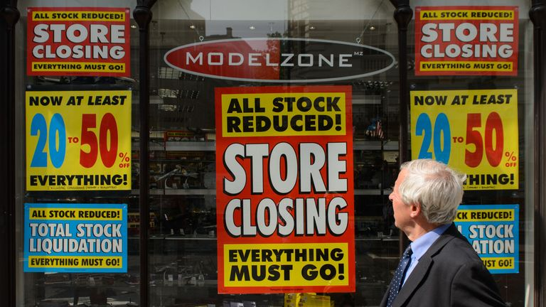 A man walks past a branch of Model Zone on High Holborn