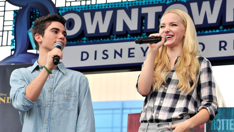 Cameron Boyce and Dove Cameron of Disney's 'Descendants' perform and join fans at Downtown Disney at Disneyland Resort on October 17, 2015 in Anaheim, California