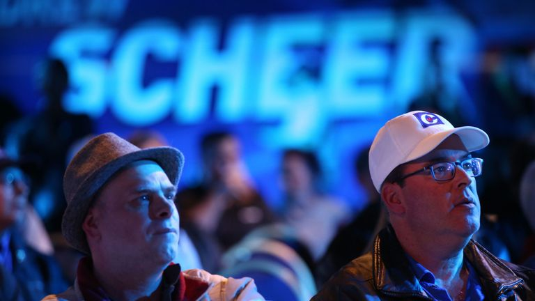 Supporters of Conservative leader Andrew Scheer react to the latest results during an election night rally in Regina, Saskatchewan on October 21, 2019