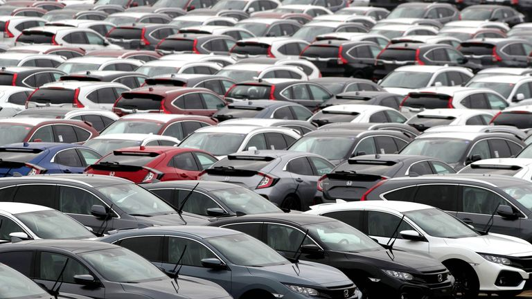 File photo dated 12/01/18 of new cars lined up. Demand for new cars has fallen 2.5% during 2019, the automotive industry has said