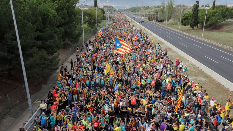 Thousands of protesters started a 100 kilometer (60 miles) march on Barcelona from regional cities
