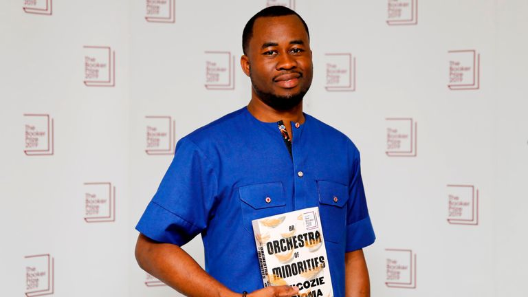 Nigerian author Chigozie Obioma poses with his book An Orchestra of Minorities during the photo call for the authors shortlisted for the 2019 Booker Prize for Fiction