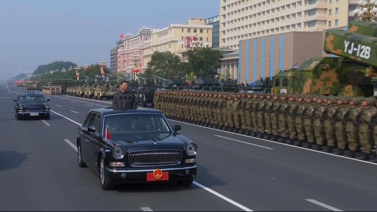 The president rode on an open-top limousine through the streets