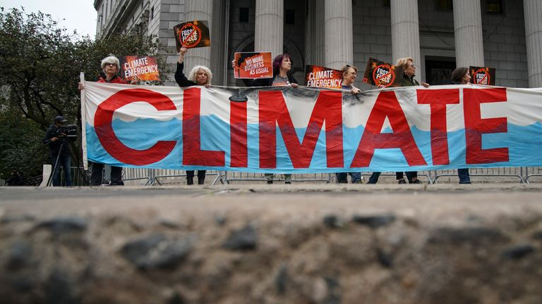Climate change protesters outside the courthouse