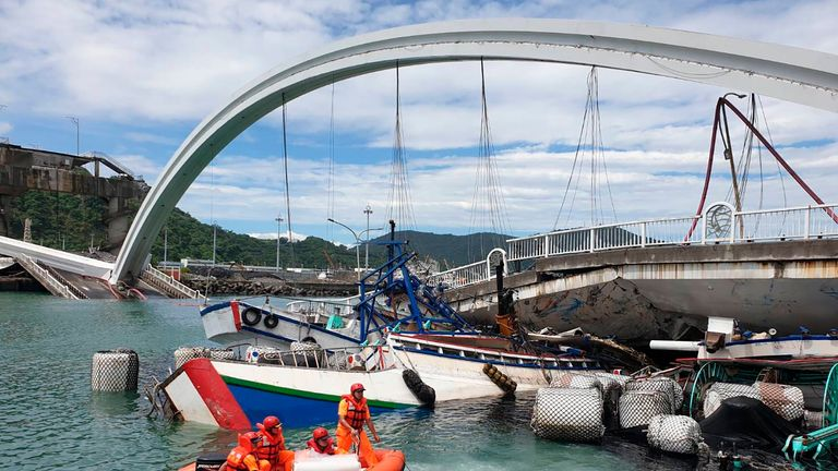 Rescuers work near the site of a collapsed bridge in Nanfangao, eastern Taiwan