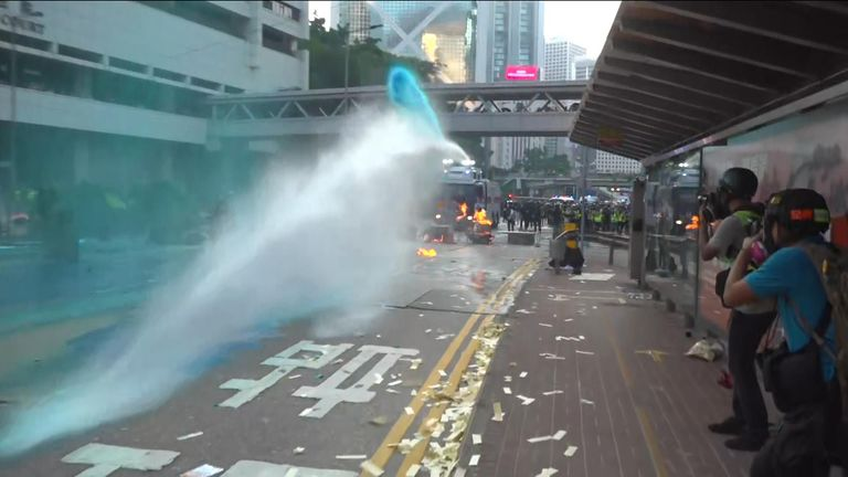 Riot police fired tear gas and water cannon on Tuesday to disperse pro-democracy protesters in several districts in Hong Kong, amid multiple rallies challenging the Chinese Communist Party (CCP) as it marks its 70th year of rule.