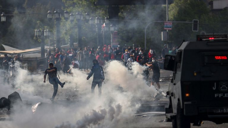 Demonstrators clash with soldiers in Santiago, Chile