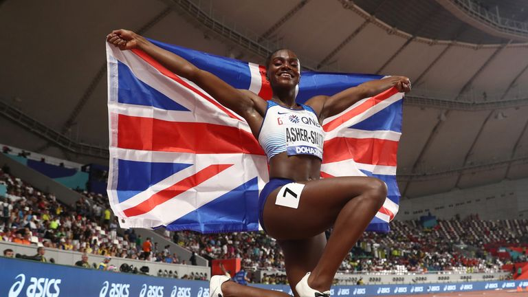 Dina Asher-Smith of Great Britain celebrates after winning gold in the Women's 200 metres final during day six of 17th IAAF World Athletics Championships Doha