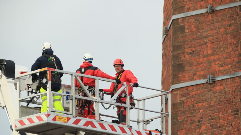 Rescue workers reached the man via a hydraulic platform after about 14 hours