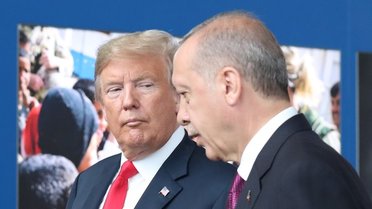 US President Donald Trump (L) talks to Turkeys President Recep Tayyip Erdogan (R) as they arrive for the NATO (North Atlantic Treaty Organization) summit, at the NATO headquarters in Brussels, on July 11, 2018. (Photo by Tatyana ZENKOVICH / POOL / AFP) (Photo credit should read TATYANA ZENKOVICH/AFP/Getty Images)