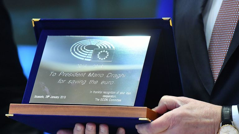 European Central Bank President Mario Draghi receives a gift from European Parliament members before addressing the committee on Economic and Monetary Affairs at the European Parliament in Brussels on January 28, 2019. (Photo by EMMANUEL DUNAND / AFP) (Photo credit should read EMMANUEL DUNAND/AFP/Getty Images)