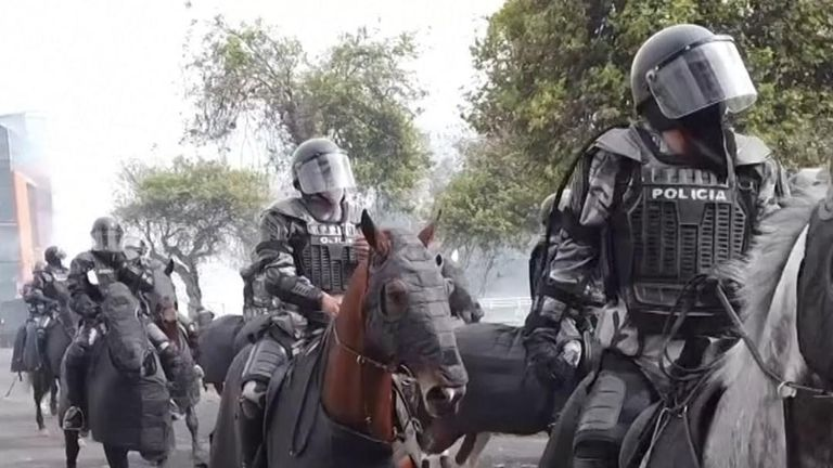 Mounted police clash with protesters over austerity measures in Quito