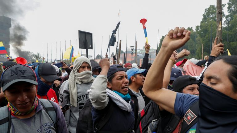 Demonstrators outside Ecuador's National Assembly, which was stormed on Monday
