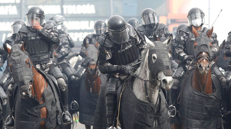 Mounted riot police tried to quell demonstrations near the Ecuadorian National Assembly