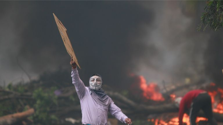QUITO, ECUADOR - OCTOBER 12: Indigenous protests outside the Comptroller's Building during the protests against the economic measures taken by President of Ecuador Lenin Moreno on October 12, 2019 in Quito, Ecuador. Ecuador faces the 10th day of protests to repeal the government's measure to end a four-decade fuel subsidy. Clashes between demonstrators and security forces have escalated leaving five people dead. President Moreno has refused to overturn the measure and protest organizers, now led by indigenous communities, have agreed to dialogue with the president. (Photo by Ricardo Landera/Agencia Press South/Getty Images)