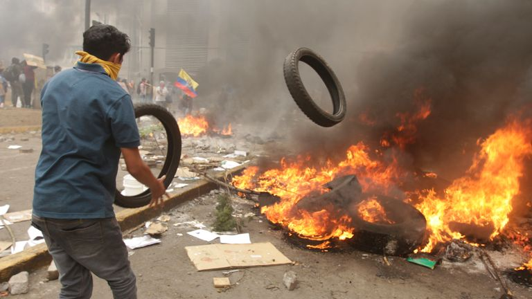 QUITO, ECUADOR - OCTOBER 12: Demonstrators  burn tires to protect against gas during the protests against the economic measures taken by President of Ecuador Lenin Moreno on October 12, 2019 in Quito, Ecuador. Ecuador faces the 10th day of protests to repeal the government's measure to end a four-decade fuel subsidy. Clashes between demonstrators and security forces have escalated leaving five people dead. President Moreno has refused to overturn the measure and protest organizers, now led by indigenous communities, have agreed to dialogue with the president. (Photo by Ricardo Landera/Agencia Press South/Getty Images)
