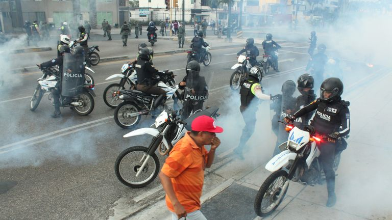 GUAYAQUIL, ECUADOR - OCTOBER 12: Police launch tear gas to disperse protesters  during the protests against the economic measures taken by President of Ecuador Lenin Moreno on October 12, 2019 in Guayaquil, Ecuador. Ecuador faces the 10th day of protests to repeal the government's measure to end a four-decade fuel subsidy. Clashes between demonstrators and security forces have escalated leaving five people dead. President Moreno has refused to overturn the measure and protest organizers, now led by indigenous communities, have agreed to dialogue with the president. (Photo by Eduardo Maquilon/Agencia Press South/Getty Images)