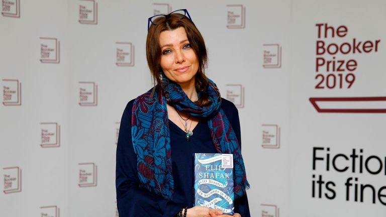 Turkish-British author Elif Shafak poses with her book 10 Minutes 38 Seconds in This Strange World during the photo call for the authors shortlisted for the 2019 Booker Prize for Fiction