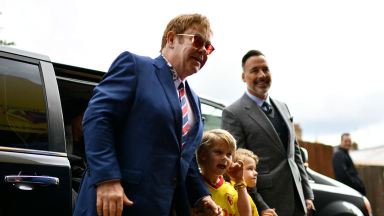 Elton John, David Furnish and their children Elijah and Zachary arrive for a match between Watford and Manchester City