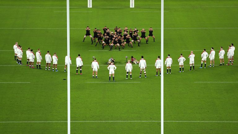 England players look on while New Zealand players perform a haka during the Rugby World Cup 2019 Semi-Final match between England and New Zealand at International Stadium Yokohama on October 26, 2019 in Yokohama