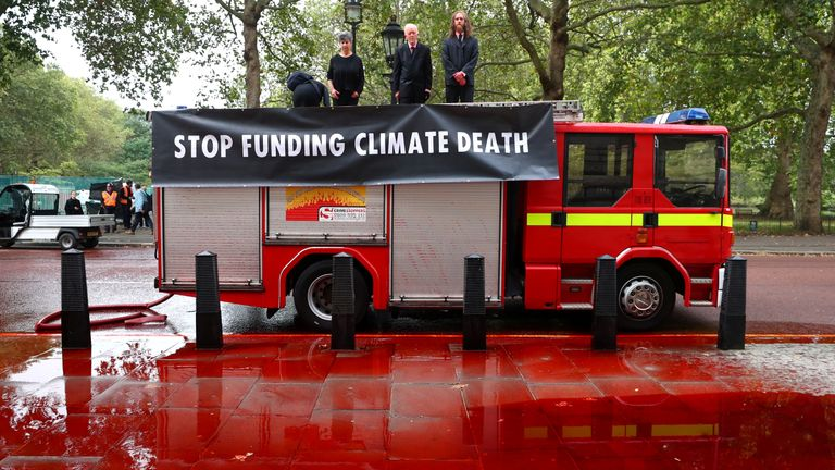 Extinction Rebellion protestors demonstrate outside the Treasury building in London