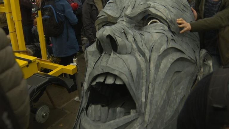 Extinction Rebellion protesters attempted to march a large steel bust along Lambeth Bridge.