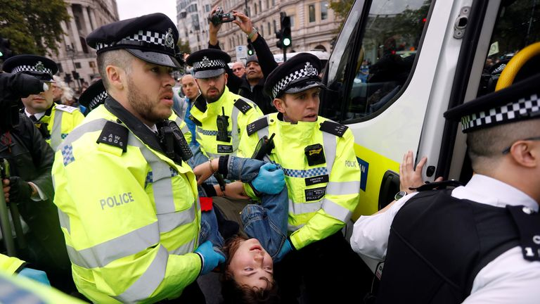 A climate change activist from the Extinction Rebellion group is arrested by police in Trafalgar Square in central London, on October 7, 2019 during the group's global climate protests. - Extinction Rebellion has scheduled non-violent protests chiefly in Europe, North America and Australia over the next fortnight. (Photo by Ben STANSALL / AFP) (Photo by BEN STANSALL/AFP via Getty Images)