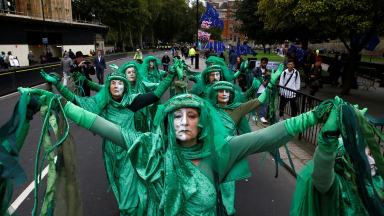 Climate change activists demonstrate outside the Houses of Parliament