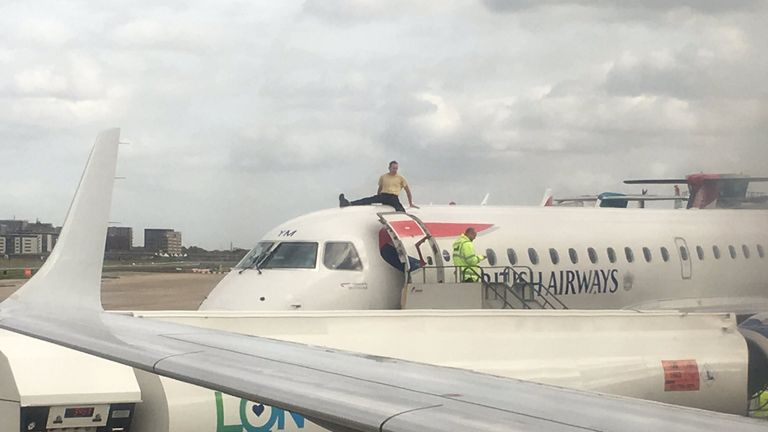 A protester on top of a plane