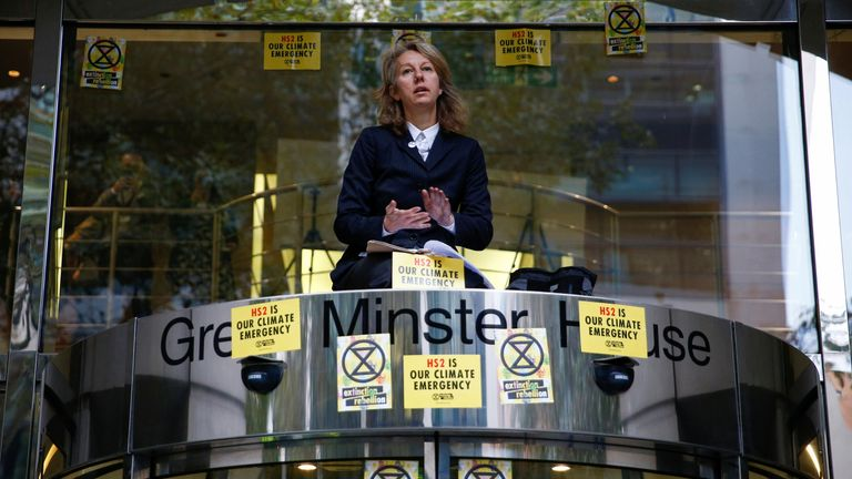 Co-founder of the Extinction Rebellion group, Gail Bradbrook, sits atop the doorway into the Department of Transport, during an Extinction Rebellion protest in London, Britain, October 15, 2019.