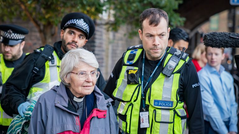 Member of Christian Climate Action - Rev. Sue Parfitt (77, from Bristol) arrested after climbing on the roof of a DLR train at Shadwell. Pic: Vladimir Morozov/akxmedia