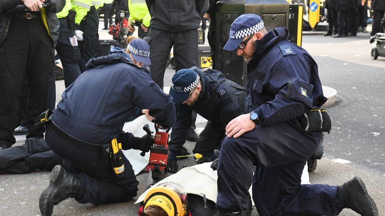 Police tried to remove pipes linking protesters together