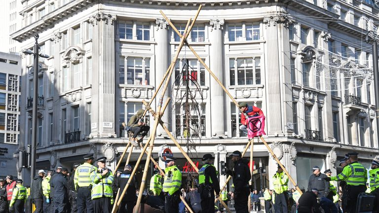 Protesters put up a bamboo pyramid in the middle of Oxford Circus