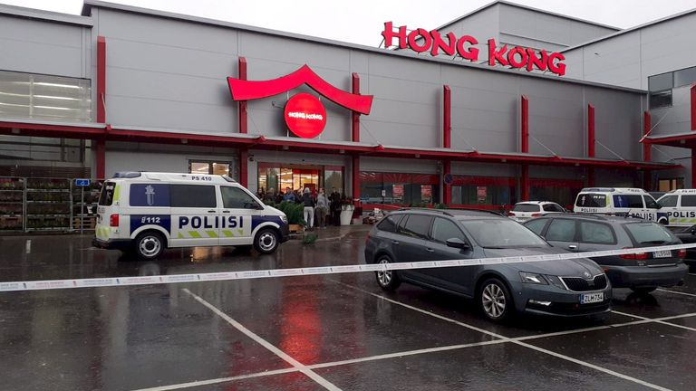 Police cars stand on the blocked grounds of the Hermanni shopping centre in Kuopio, Finland