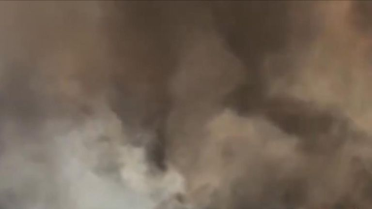 Huge smoke clouds billow over residential areas in California