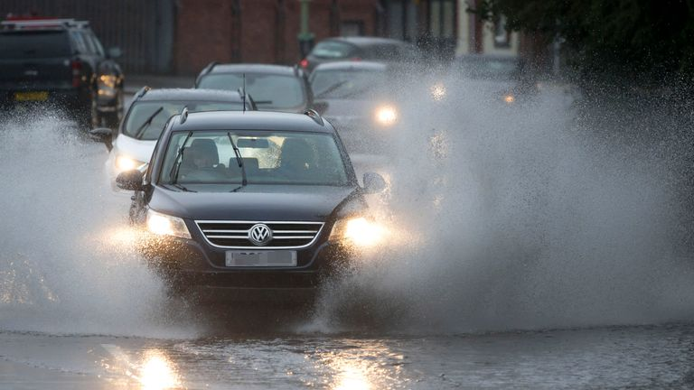 A car drives through a flooded road in Pontypridd. File pic