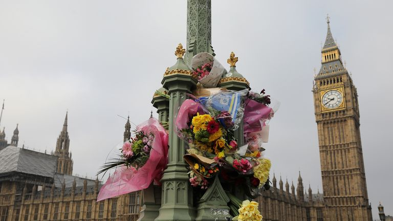 LONDON, ENGLAND - MARCH 27: Flowers are left on Westminster Bridge by the Houses of Parliament in memory of those who died in last weeks Westminster terror attack on March 27, 2017 in London, England. Five people including the assailant were killed and around 40 people injured following last week's attack outside the Houses of Parliament in Westminster. (Photo by Dan Kitwood/Getty Images)