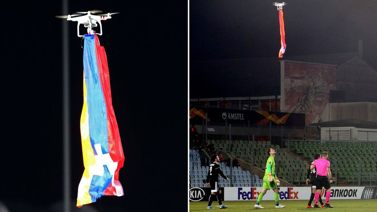 A drone flies over the pitch interrupting the match